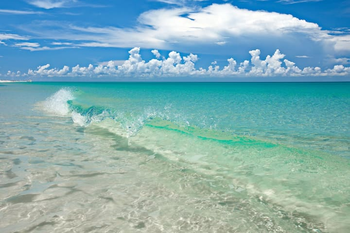 This photo was taken at the beach just a 3 minute walk from the townhouse. Gorgeous white sand and emerald waters await.