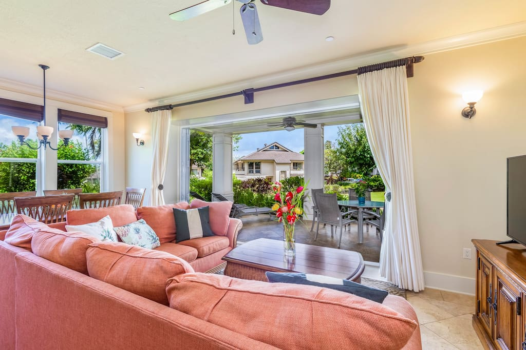 Enjoy the tropical ocean air from inside the villa with the folding lanai doors.