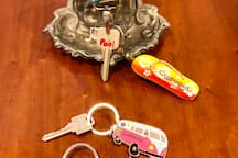 Pool key and the house keys are left on the kitchen armoire