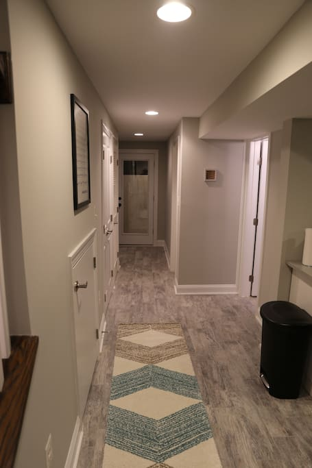 Hallway leading to the bathroom, bedroom, and entrance