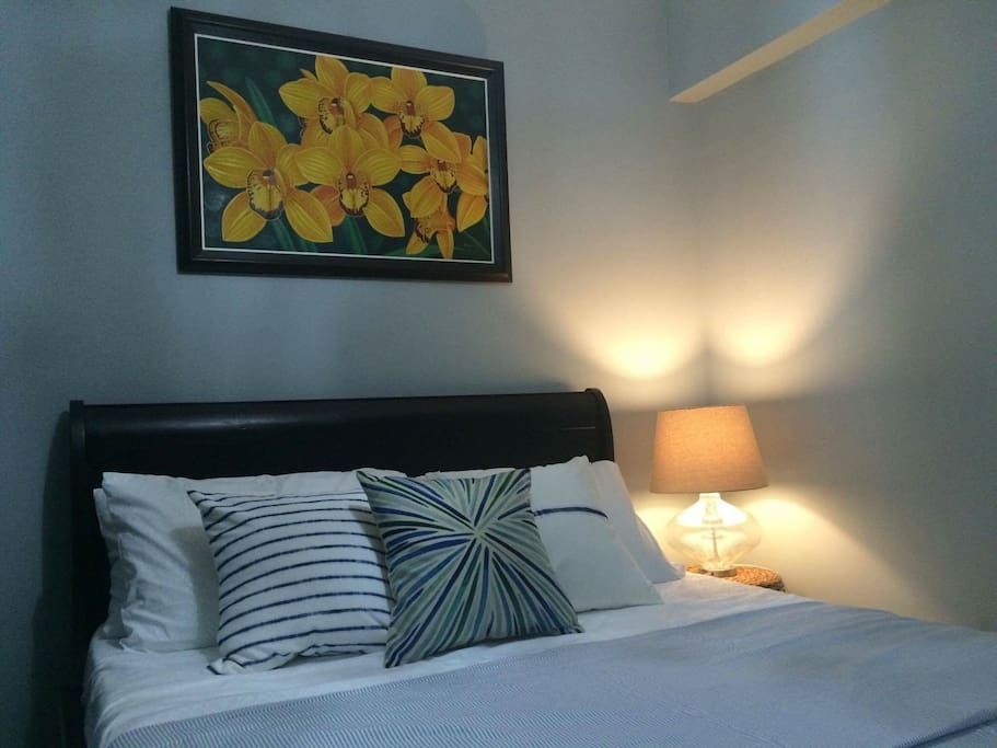 Master Bedroom at Lotus House. The capiz ceiling lamp is made from oyster shells abundant in Philippine waters.