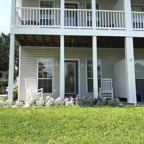 Back of the property showing balcony and porch