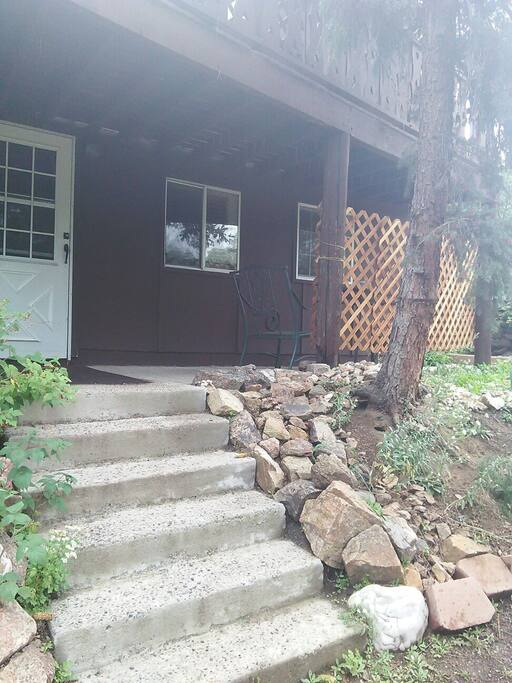 Front door of the unit. Private patio with table and chairs to the right, behind the lattice. Great place to have food and drinks. Enjoy the Colorado Summer.