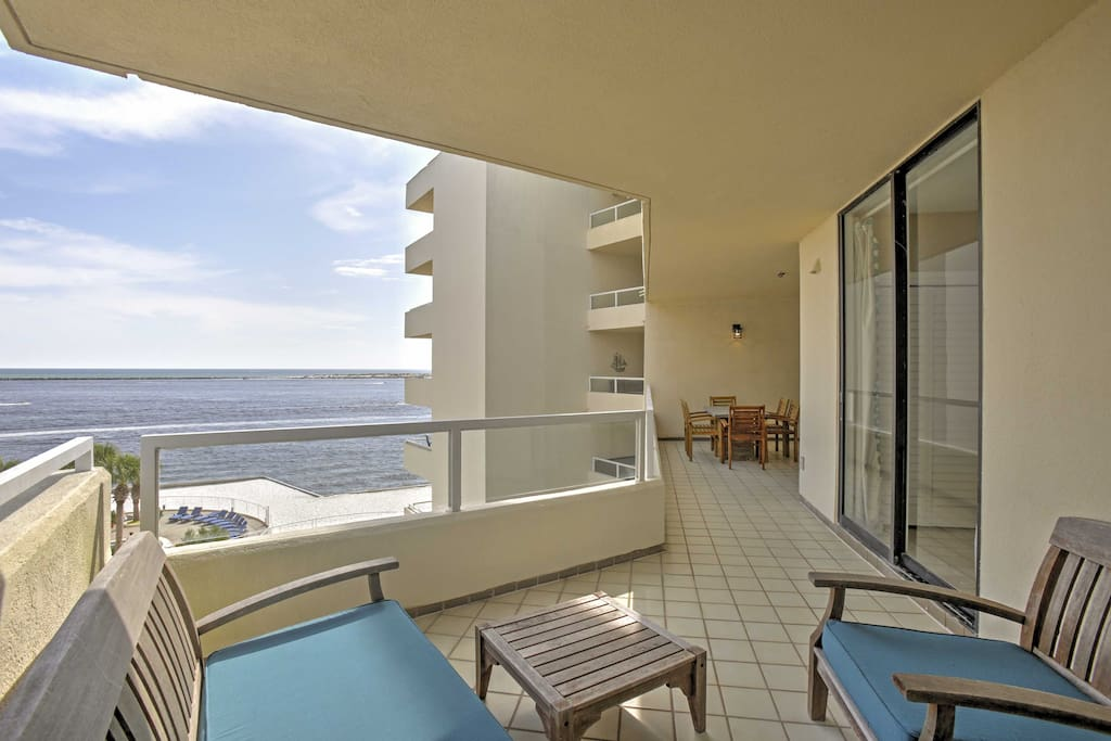 The beachfront condo features a spacious patio that overlooks the ocean.