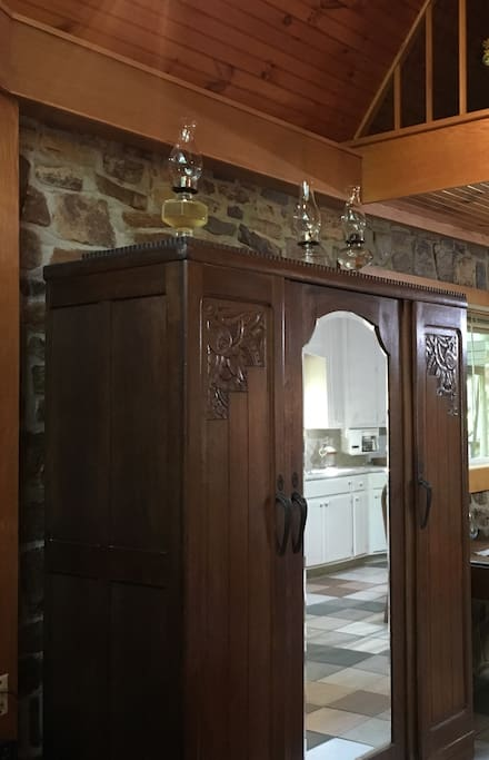 The antique armoire downstairs has storage for both hanging and folded clothes, and avoids carrying lots of heavy luggage upstairs.