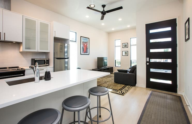 Relax in this modern, newly-built Uptown home