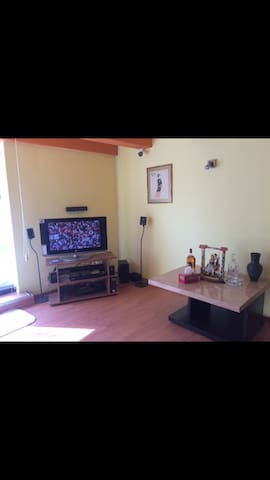 Living room equipped with TV and surround system