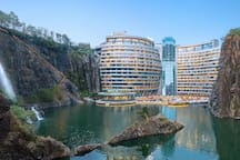 This is the Intercontinental Shanghai Wonderland hotel. The hotel is under the horizon, used to be a mining land.