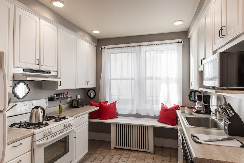 The updated kitchen with modern appliances and generous bench seating makes for fun-filled cooking.