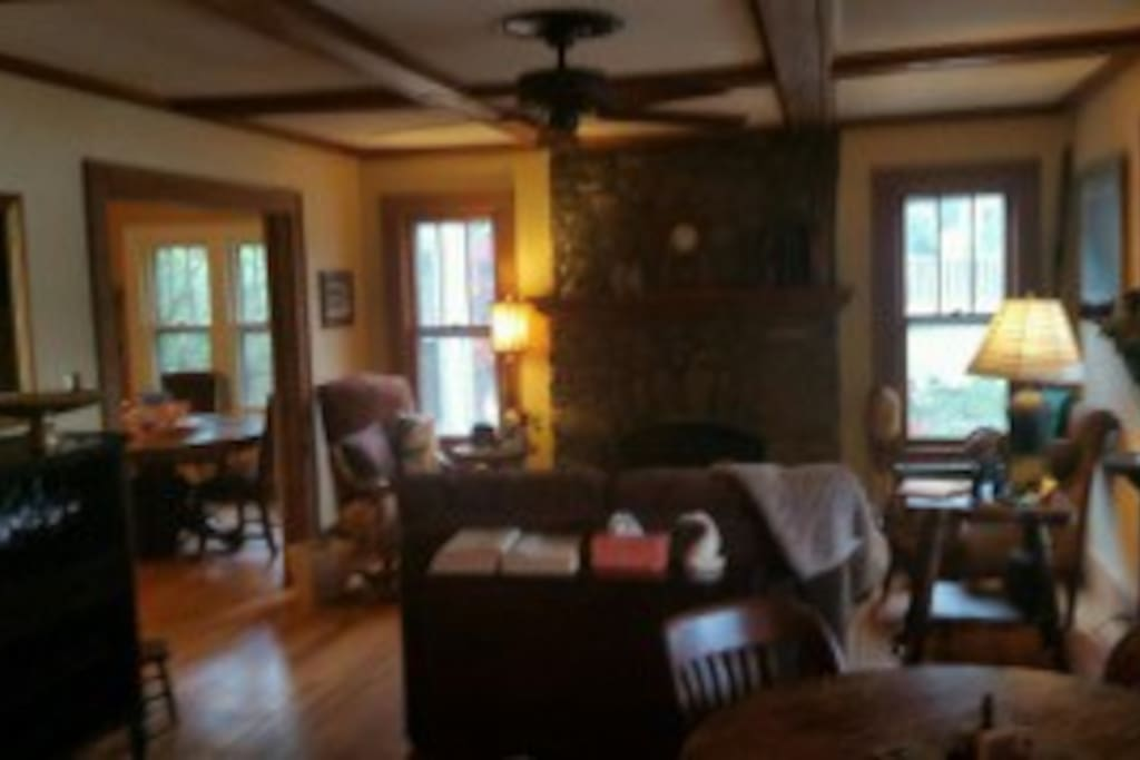 Spacious living room with fireplace - room for everyone to find a cosy nook