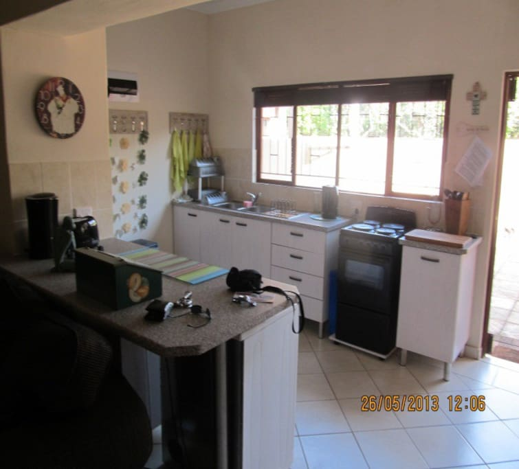 Spacious open plan kitchen with all cutlery, crockery etc.