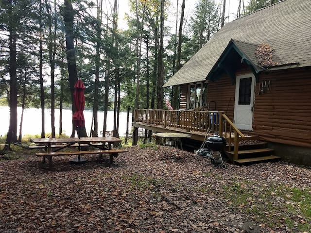 Beautiful lake view on a wooded 2 acre lot. New, oversized picnic table and umbrella for outdoor dining or relaxing outside