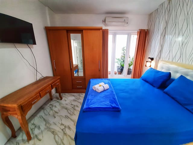 Bed with queen size bed, air conditioner, television with the National channel