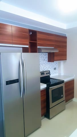 Kitchen including toaster, electric kettle, microwave