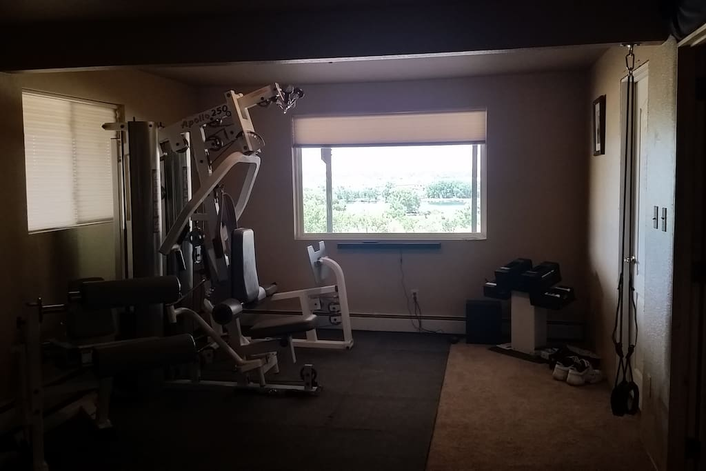 Work out equipment located in room, blue tooth speaker bar, view of the Bookcliffs, Connected Lakes, and the Colorado River