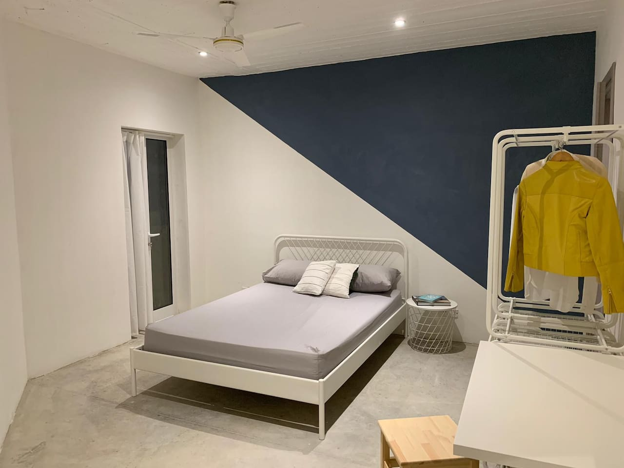 BLUE ROOM - The well-lit second floor double bedroom has a contemporary aesthetic, a balcony and a private en suite bathroom.
