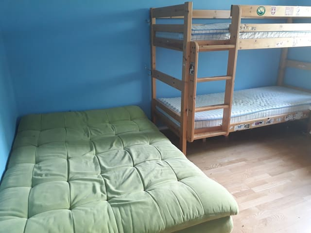 Second bedroom with a 80cmx200cm bunk bed and a foldable 120cmx200cm bed couch. TV and a freezer.