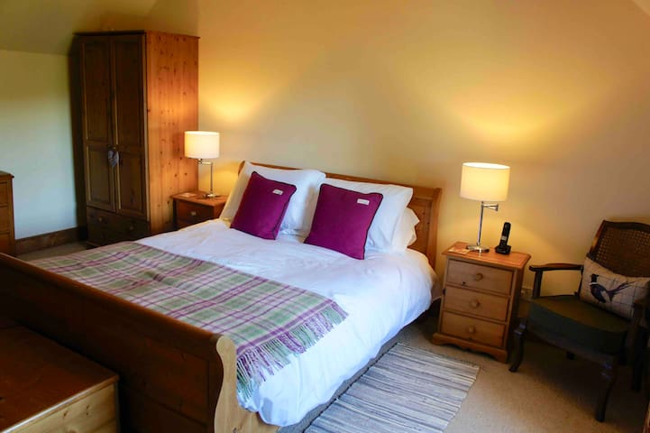 Main bedroom, overlooks the garden and view of Cateran Trail in the distance, with king-size bed and newly refurbished en-suite shower room with WC