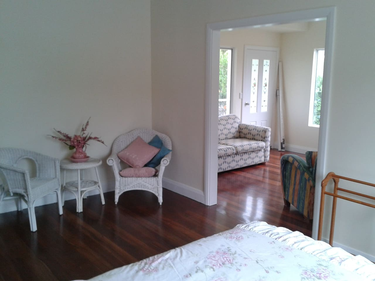 Queen bedroom looking through to sun room. White dividing doors have since been added
