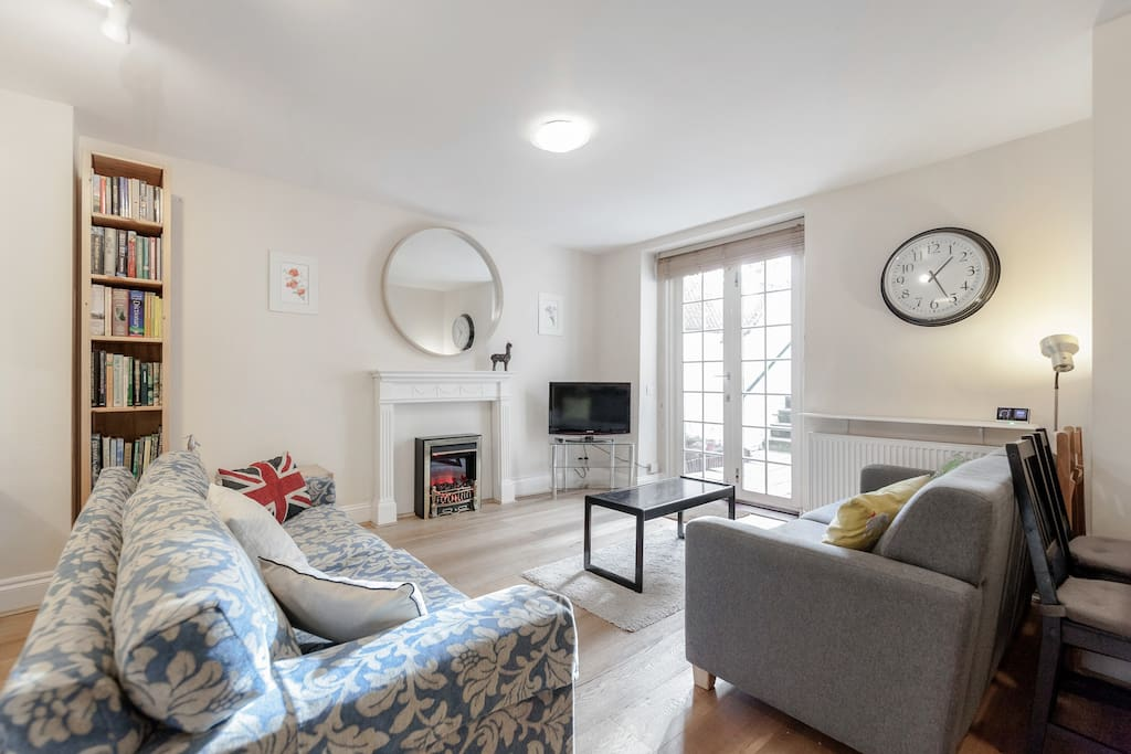 Open plan living room with electric  fire, great for cozy evenings.