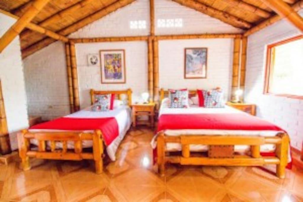 habitación cama doble y sencilla