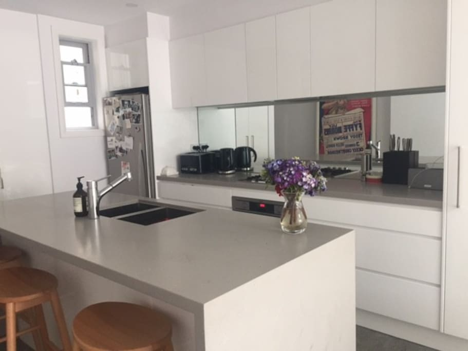Fully equipped modern kitchen, with breakfast bar.