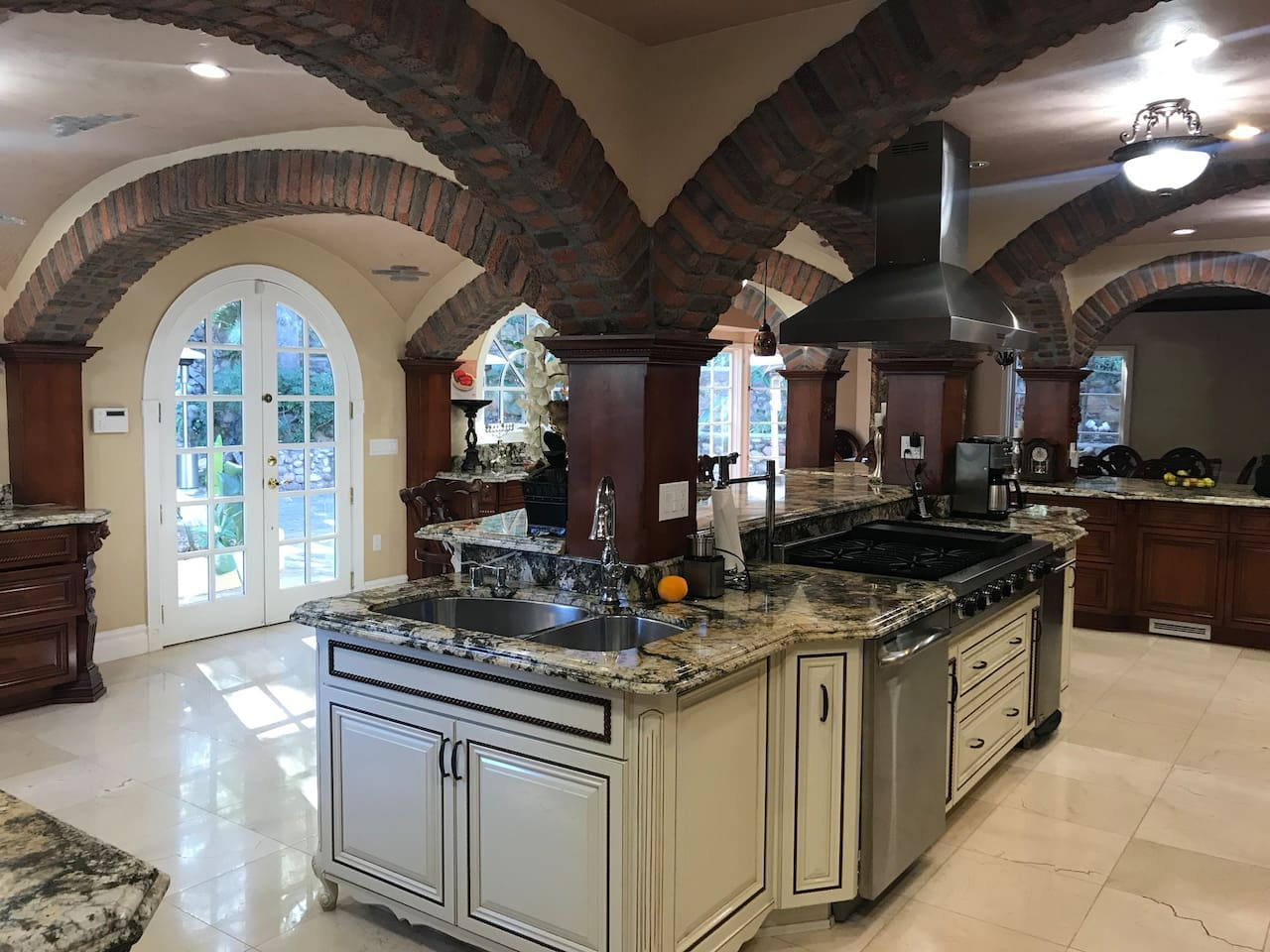This kitchen been designed by Italian architect and it's replicated famous restaurant in Venice Italy. The granite slabs made of one piece imported from Italy and there is no second to that in the world. It cost over $750k to build it in 2014.