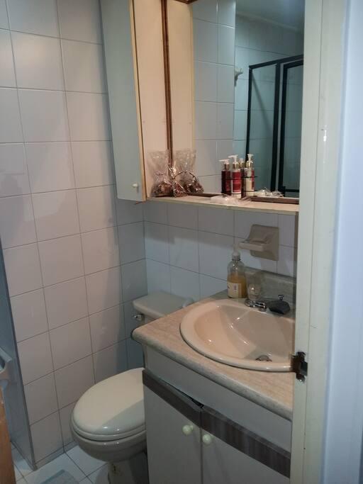 bathroom with shower next door