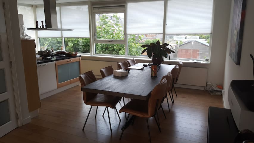 View to kitchen and dining table