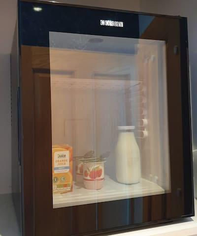 Mini Fridge in Jacobite Room at Water's Edge. Orange Juice, Milk and Yoghurt supplied as part of the in room breakfast. Contents may vary depending on availability.
