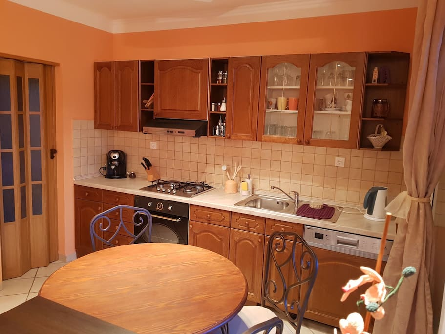 Dinning room & kitchen with dish washer, coffee machine, oven, kettle