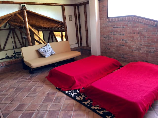 Second-floor area, with two twin beds and a sofabed, with private bathroom