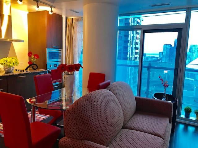 Living room and dining room with amazing viewing of the lake, Rogers Centr and CN Tower