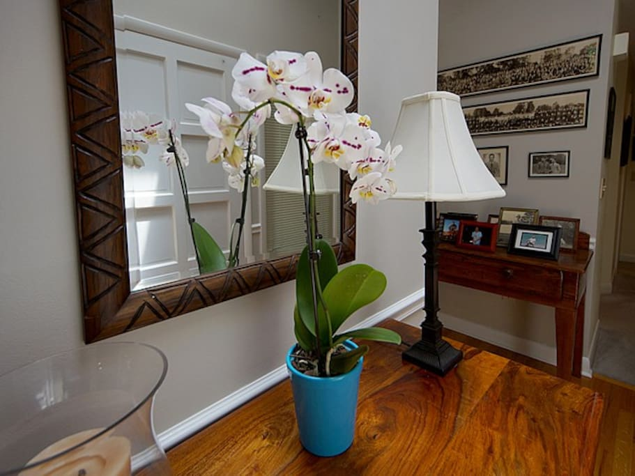 Flowers typically help to greet you beneath a skylight in the bright foyer