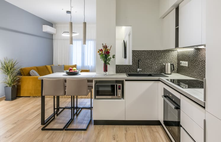 Uber modern kitchen with living room behind