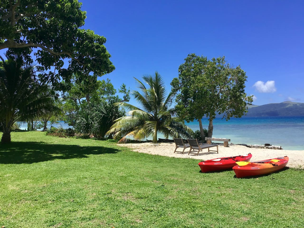 Top beach  and kayaks in front of house