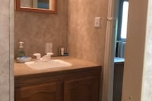 Bathroom sink,next to master queen bedroom with private entrance.