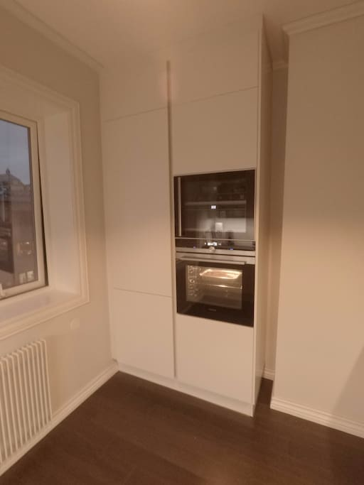 Brand new modern kitchen with integrated oven, refrigerator and freezer