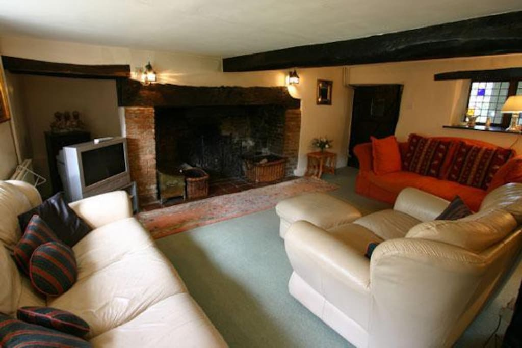 Large comfy sitting room with a cosy inglenook fireplace