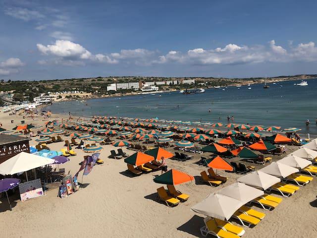 Mellieha Bay free sandy beach a 10 minute walk.
