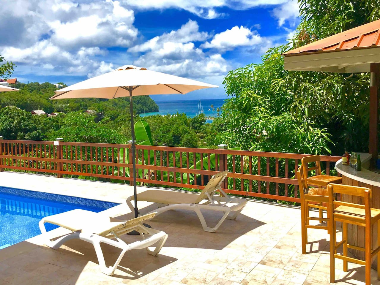 Relax and chill by the pool and how about a local beer Piton while you relax and admire the view.