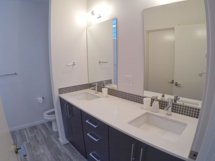 Luxurious double sink bathroom with heated floors