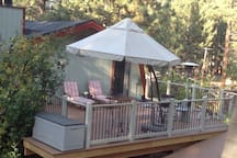 Expansive deck with areas for lounging during summer season.