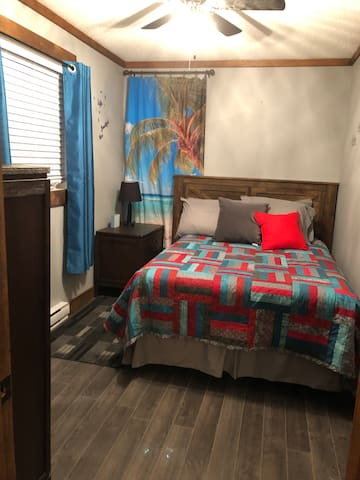 Rooms with hand made quilts . Double bed and a queen bed.