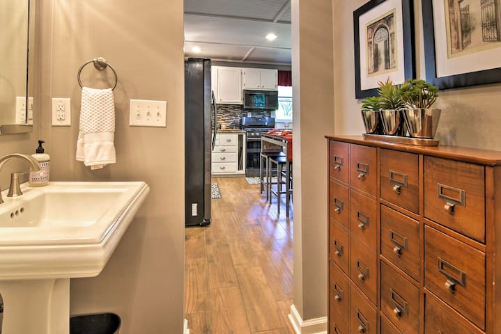 The bathroom is located right next to the kitchen.