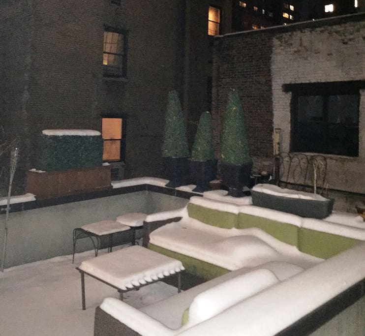 Large private outdoor terrace for this apt. only.  On the 3rd floor with large outdoor sofa, table, and chairs.