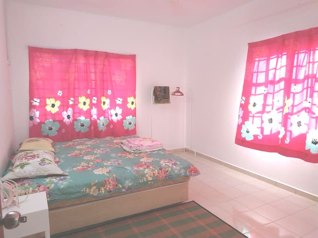 Master Bedroom with aircond. Queen size bed with attached private bathroom.