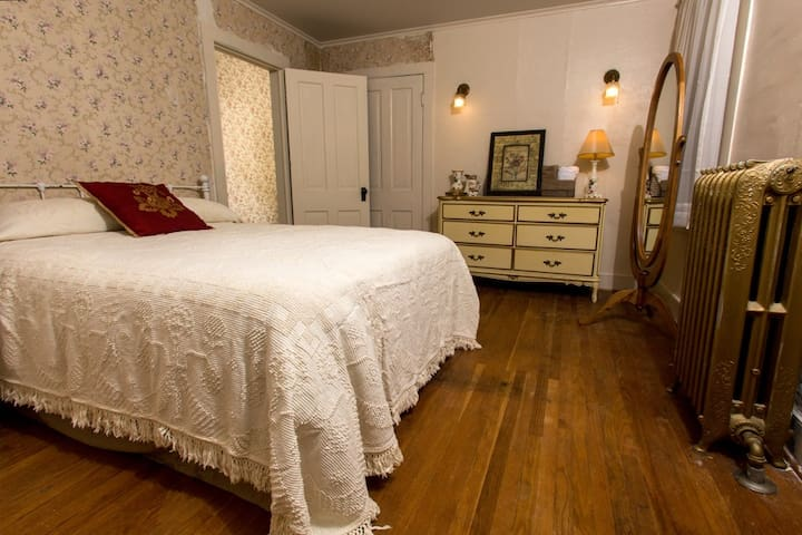 This is Room #5 which  is on the second floor, has a queen bed, and shares a bathroom.