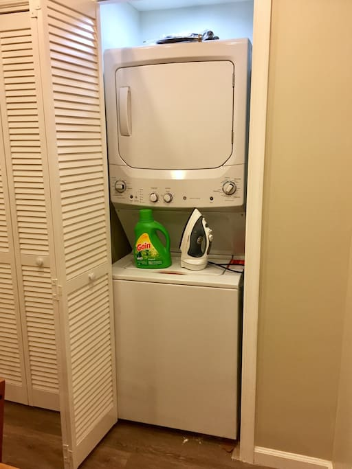 Wash your clothes in the washer and dryer with detergent provided. Also available is an iron and small ironing board.