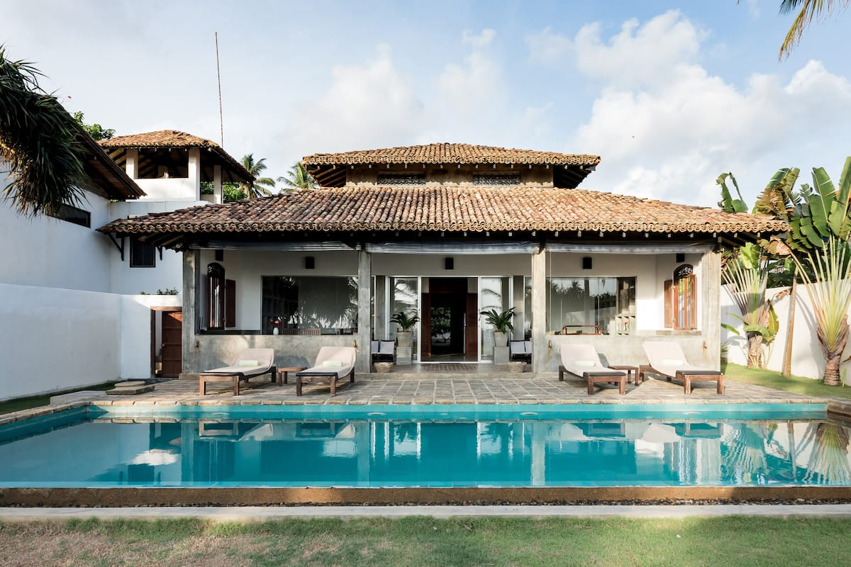 Green Parrot Beachfront Villa with Private Pool